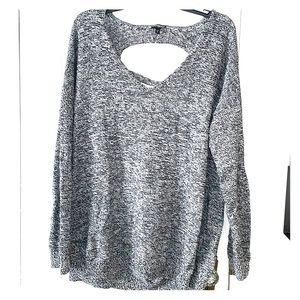 Express sweater with cut outs along middle back